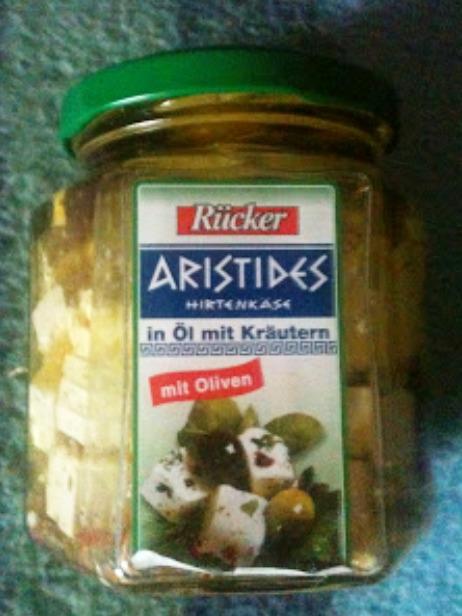 Aristides mit Öl, Kräutern und Oliven